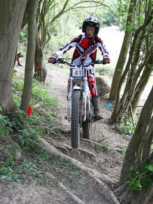 Ollie floats neatly over surprisingly dry roots at GC's Brookthorpe easy trial. Pic: Colin Jones.